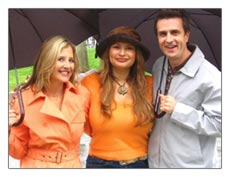 Shirley and. hosts Christine Blackburn and Dan Sachoff get caught in the rain in Venice, California.